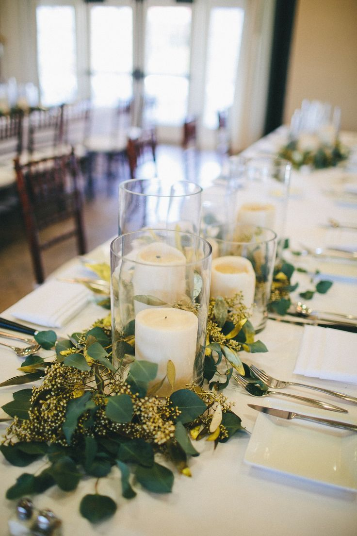 1/2 of the table centerpieces will be clusters of pillar candles in vases and gold mercury glass votives at varied heights with seeded eucalyptus, olive leaves, and Italian ruscus tucked in between.