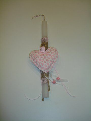 Handmade Easter candle decorated with fabric item. www.artimiva.gr