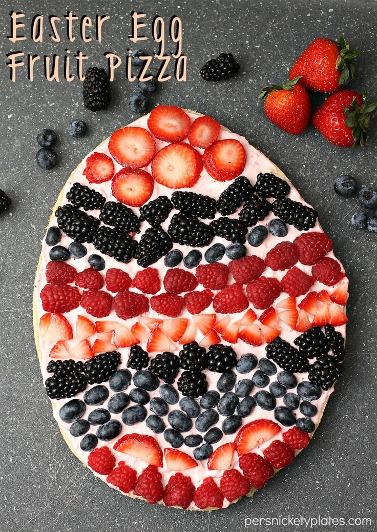 A sugar cookie base with a strawberry cream cheese frosting makes the perfect Easter Egg Fruit Pizza. Fun to decorate with the kids!