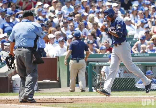 Milwaukee Brewers Domingo Santana scores against the Chicago Cubs in the third inning at Wrigley Field on July 6, 2017 in Chicago. Photo by…