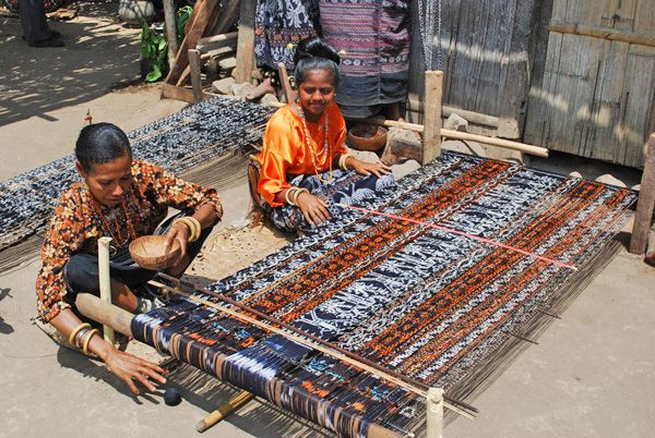 Ikat weaving in action from Adventures of the Red Headed Traveler: FIndonesia