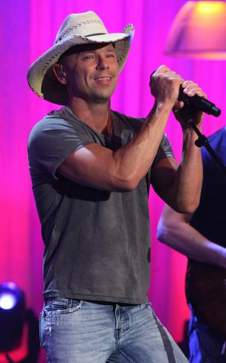 Kenny Chesney...saw him in the mid-90s when he was just startin' out...he was one of the many performers at the Country Fest at Atlanta Motor Speedway...it poured down rain part of the time and it was hot as HELL...in July...but we had a great time.