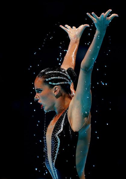 Carbonell Ballestero of Spain competes in the Synchronized Swimming Free Combination preliminary round on day two of the 15th FINA World Championships at Palau Sant Jordi on July 21, 2013 in Barcelona, Spain.