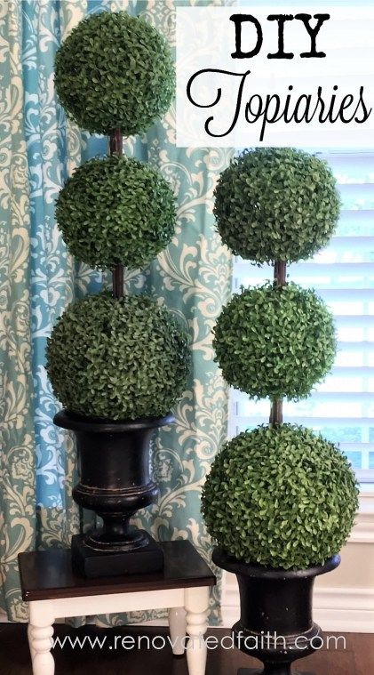 DIY Topiaries with Tiered Boxwood - I made them at a fraction of the cost of those sold in stores and was able to make them exactly the size I wanted.  I have gotten many compliments on these topiaries and they have held up well over the past two years, even in the hot Texas sun.