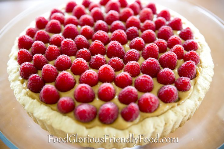 Raspberry Lemon Butter Tart.  Perfect for any celebration, this would make a beautiful Christmas dessert.  Free from gluten and nuts.  Can be dairy free and refined sugar free.  http://www.foodgloriousfriendlyfood.com/blog-and-recipes/raspberry-lemon-butter-tart