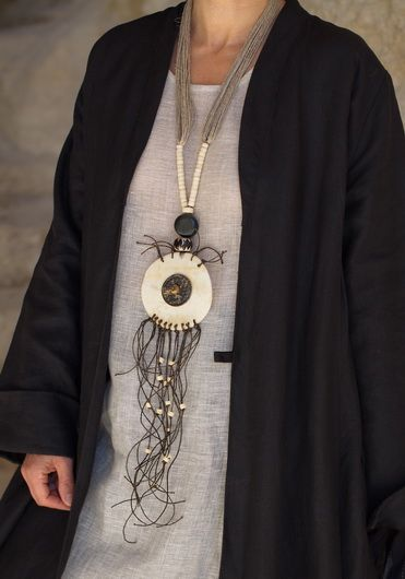Unique Necklace: Large round piece of bone decorated with an ancient Chinese coin, ethnics beads, linen string.