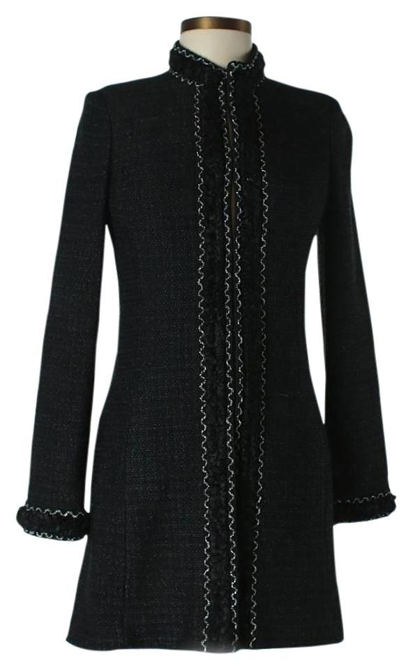 """St. John Couture Black Metallic Boucle Knit Silver Topper Jacket Coat. Metallic black and sliver boucle knit 3/4 length topper jacket with woven knotted trim and hook front closures, two pockets. Excellent very gently used condition with a few minor snags or pulls to knit or trim. Silk textile interior lining. Size US 4. Measurements: Bust 34"""", Length 32"""", Sleeve Length: 25"""" Materials not listed to care tag. Dry Clean Only. Made in the USA. Inventory No. 050910. Estimated Retail $2,500.00…"""