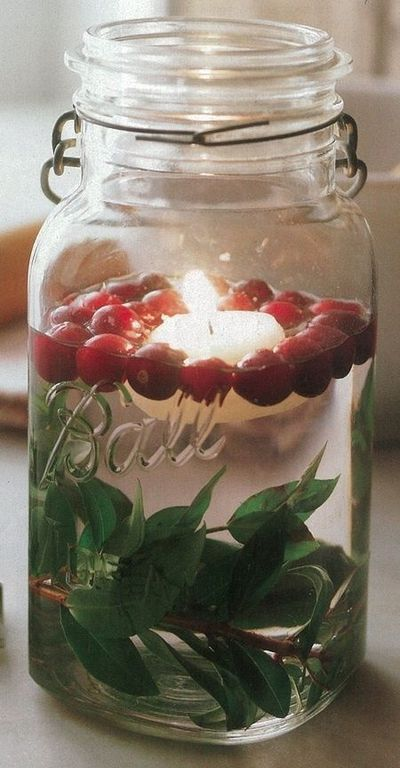 Christmas mason jar decoration: Leaves, cranberries (they float!), and a floating candle. Rustic and simple!