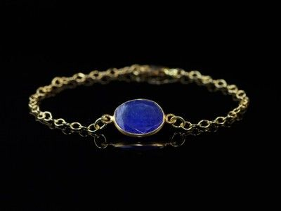 Gold Bracelet with Ratnapuri   Chain with round facetted disc-shaped Ratnapuri Sapphire