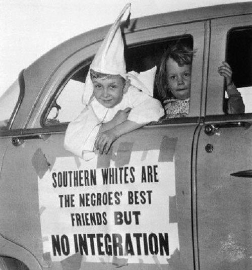 """""""Southern whites are the negroes' best friends but no integration."""" Child protester in KKK garb, 1956"""