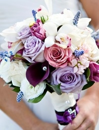 White and purple are perfect together. The white enhances the vibrancy of the purple flowers. #bridal #bouquets #wedding #flowers #purple