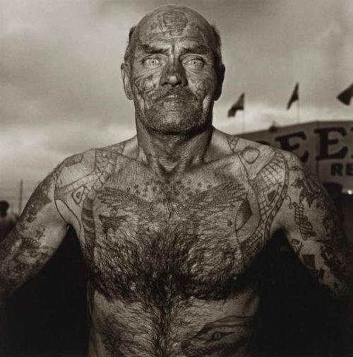 Diane Arbus' photo of a 'Tattooed Man'. Weird to think that was his main criterion of employment, no?