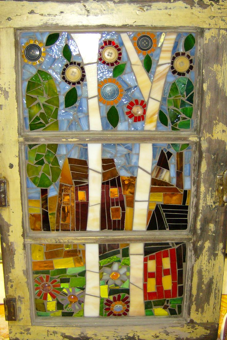 Glass mosaic of houses & trees in old window