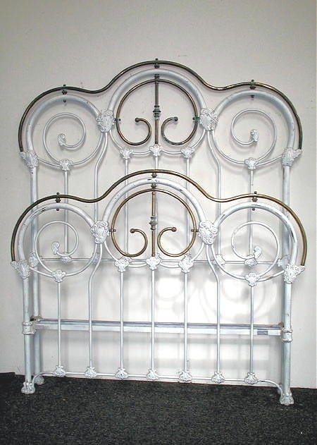 Victorian bed frame from the Chicago area w/ very unusual curved brass top.