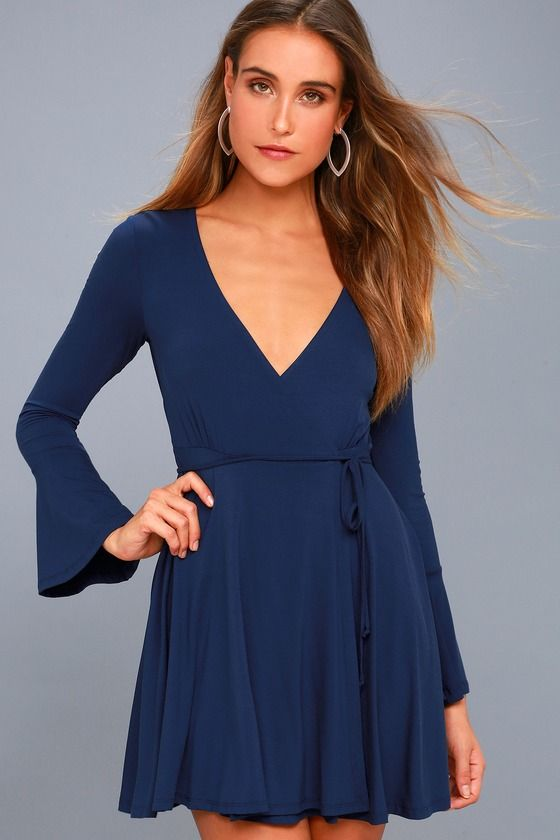 Lulus Exclusive! Keep em' guessing in the Plot Twist Navy Blue Flounce Sleeve Wrap Dress! Soft jersey knit fabric sweeps down fitted long sleeves, with flounce cuffs, into a wrapping surplice bodice with tying sash belt. Lightly flared skirt falls to a flirty hem.