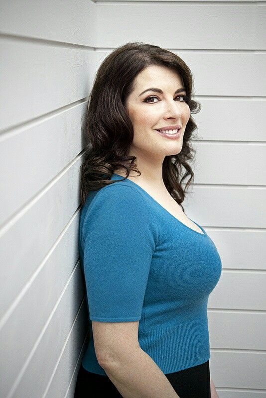 Nigella Lawson amply displaying where all those calories go.