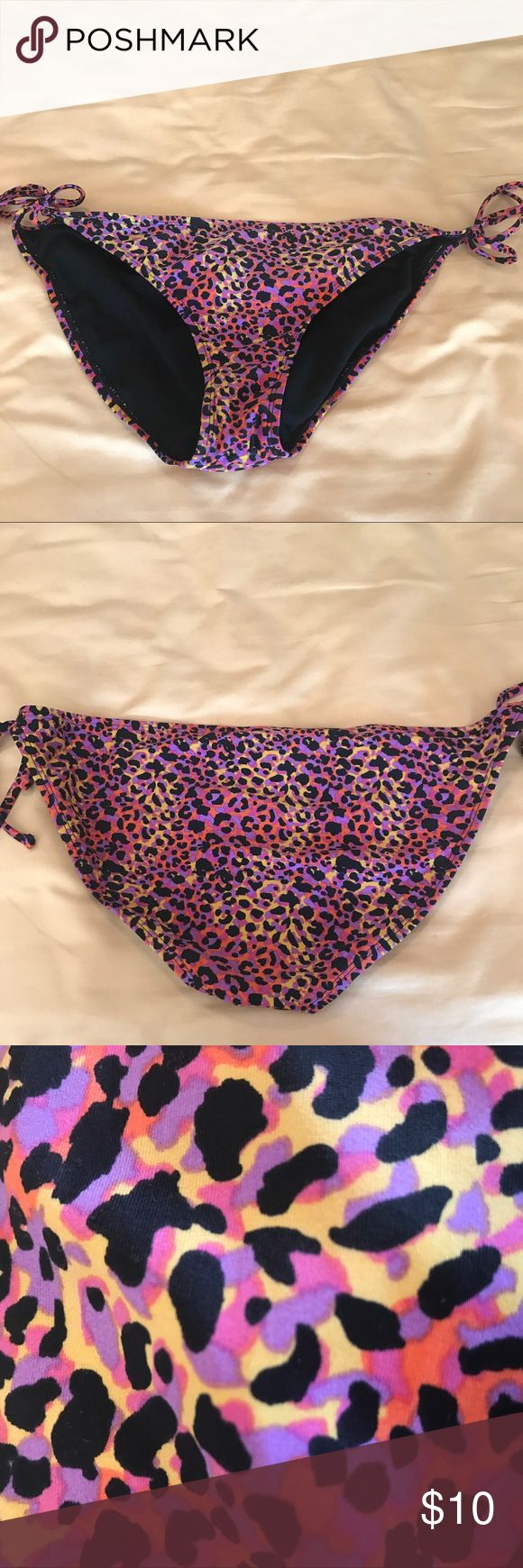 Leopard print drawstring bikini bottoms Multi colored leopard print drawstring bikini bottoms; too big for me now but was very flattering and try to size; looked great with solid black or solid matching colored top! Xhilaration Swim Bikinis