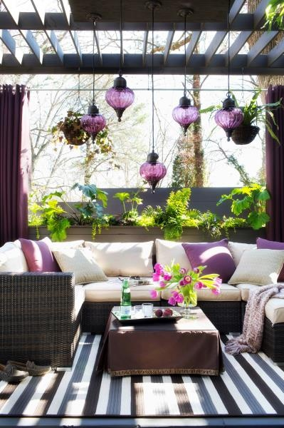 I am in love - purple hanging lanterns, white sofa/cushion, purple accents everywhere!