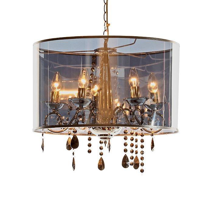 LUXURY LUX Kronleuchter Ein spannender Mix zwischen Kronleuchter und Schirmlampe ist Luxury Lux - und noch spannender ist die Verwandlung von Licht aus zu Licht an. Denn während der Kronleuchter zuerst nur leicht durchschimmert, kommt er plötzlich prächtig zur Geltung. Aus verchromtem Metall und Kunststoff, mit Glas-Ornamenten. Groesse: Höhe ca. 32 cm, Ø ca. 50 cm Material: Aus Metall mit verchromten Glas-Ornamenten und Lampenschirm aus halb-transparentem Kunststoff.