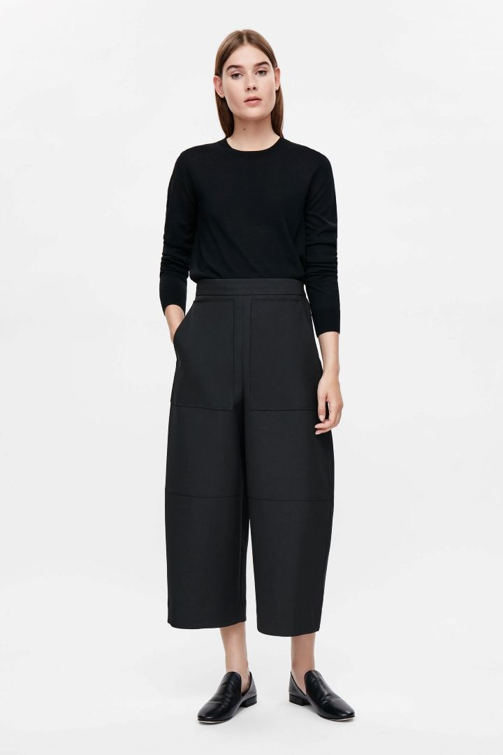COS image 1 of Oversized cropped trousers in Black