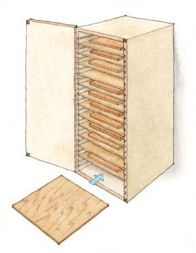 Bill gabinete papel de lija Duckworths cuenta con estantes ajustables y un sistema incorporado en el cortador de papel.  - Click para ampliar