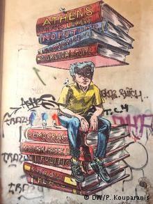 Ένας νέος με μία στοίβα από βιβλία στο κεφάλι του σε τοίχο στον Κεραμεικό