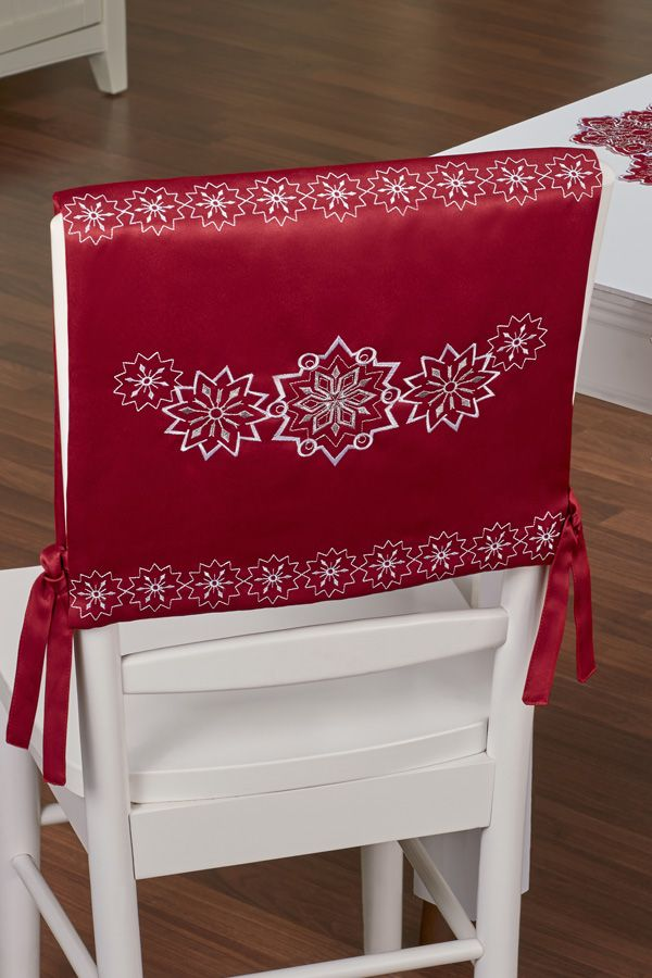chair cover elegance palecek dining chairs the snowflake set decorates with a flurry of holiday perfect in any winter wonderland each dark red has