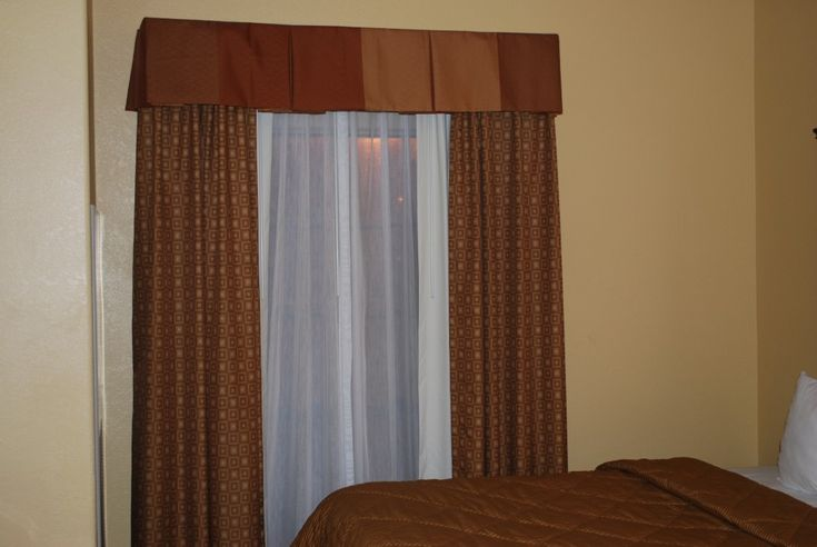 Hotel Curtains - (Disregard the picture of the ugly brown curtains.) Pinning this as the source for the curtain tracks and equipment.