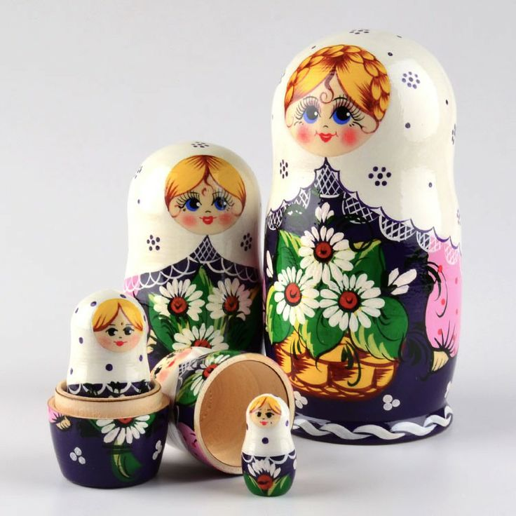 Nesting doll with daisies
