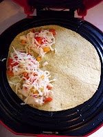 Regular Quesadilla w/ Chicken. Low fat cheese and tons of veggies make the filling for this recipe. Dip in greek yogurt or fat free sour cream. 230 calories.