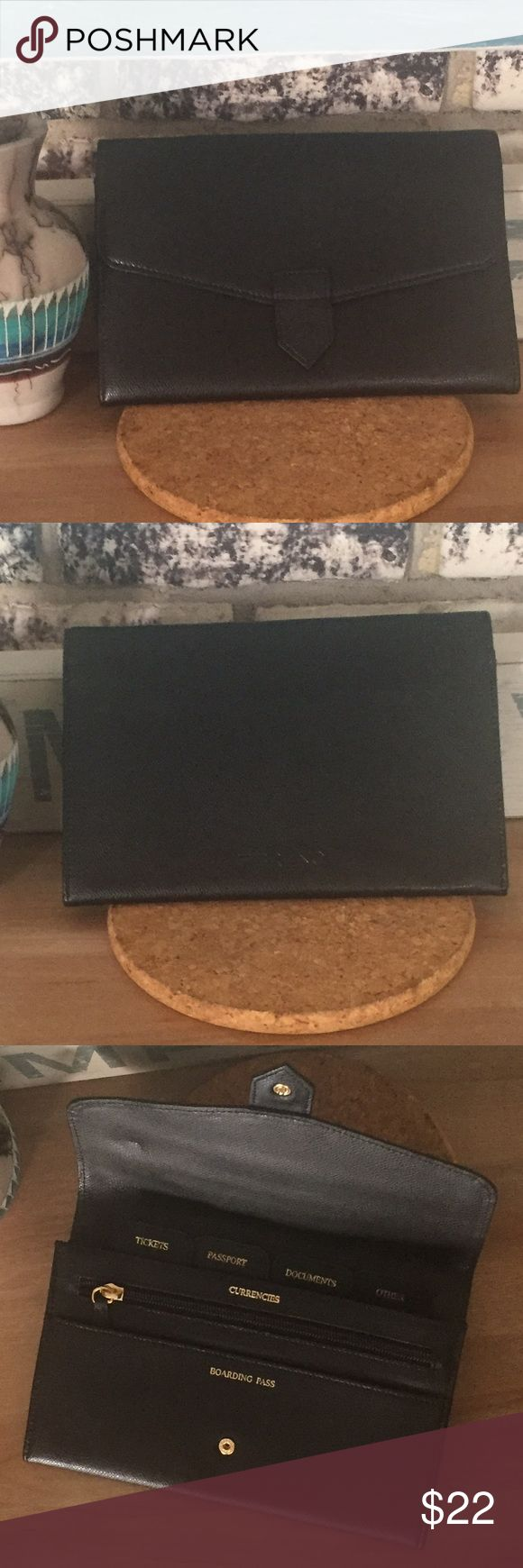 """Handy Black Travel Passport Wallet Excellent for keeping all of your important travel documents together & organized in one slim, convenient holder. Pebbled black vegan leather with gold hardware. Snap closure opens to nicely labeled dividers for Boarding Pass, Currencies, Tickets, Passport, Documents & Other. Zip pocket for loose change/currency. I never used this. Approx. size: 9"""" x 6"""" x 1/2"""" Accessories"""