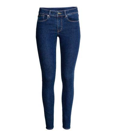 Dark denim blue. 5-pocket, low-rise jeans in washed superstretch denim with skinny legs.