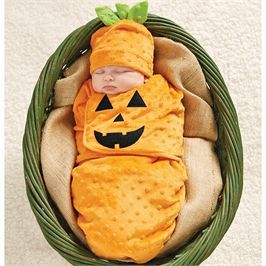 Jack-O-Lantern Pumpkin Swaddle Bunting & Cap Set makes a great warm Halloween Costume for Newborn Baby! Dot minky pumpkin swaddle features Velcro closure and arrives with coordinating hat.