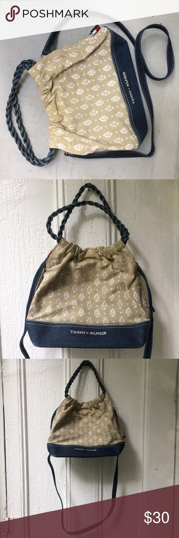 Tommy Hilfiger denim & canvas crossbody purse A very cute 90's-style Tommy Hilfiger purse with twisted denim rope circular handles, an adjustable denim strap, and roomy canvas/denim small tote with interior zipper pocket and single magnet closure. Sweet white kaki floral print design. Fully lined in classic red. Barely used and very clean. Tommy Hilfiger Bags Crossbody Bags