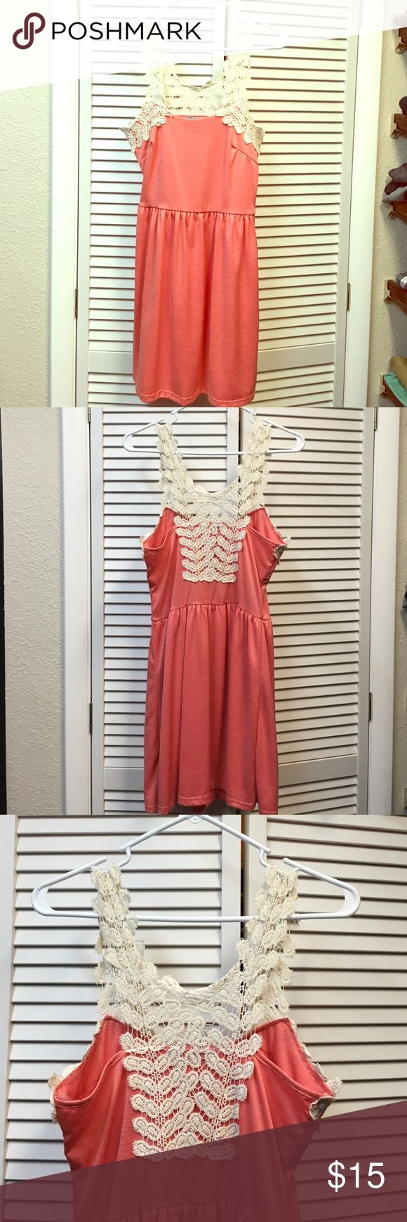Coral lace dress Coral lace dress. Great airy, summer dress for picnics or BBQs. Material is stretchy and flattering. Worn once, great condition. From Francesca's boutique. Length from shoulder is 35.5 inches Francesca's Collections Dresses Mini