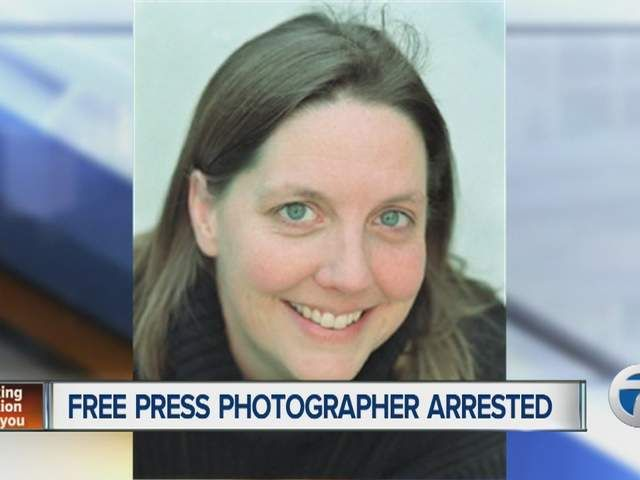 A Detroit Free Press photographer is thrown behind bars for something many of us do regularly, but one police officer thought she crossed the line.