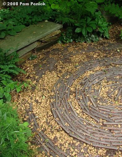 Pretty spiral paving create by turning slate on edge in crushed -granite base.