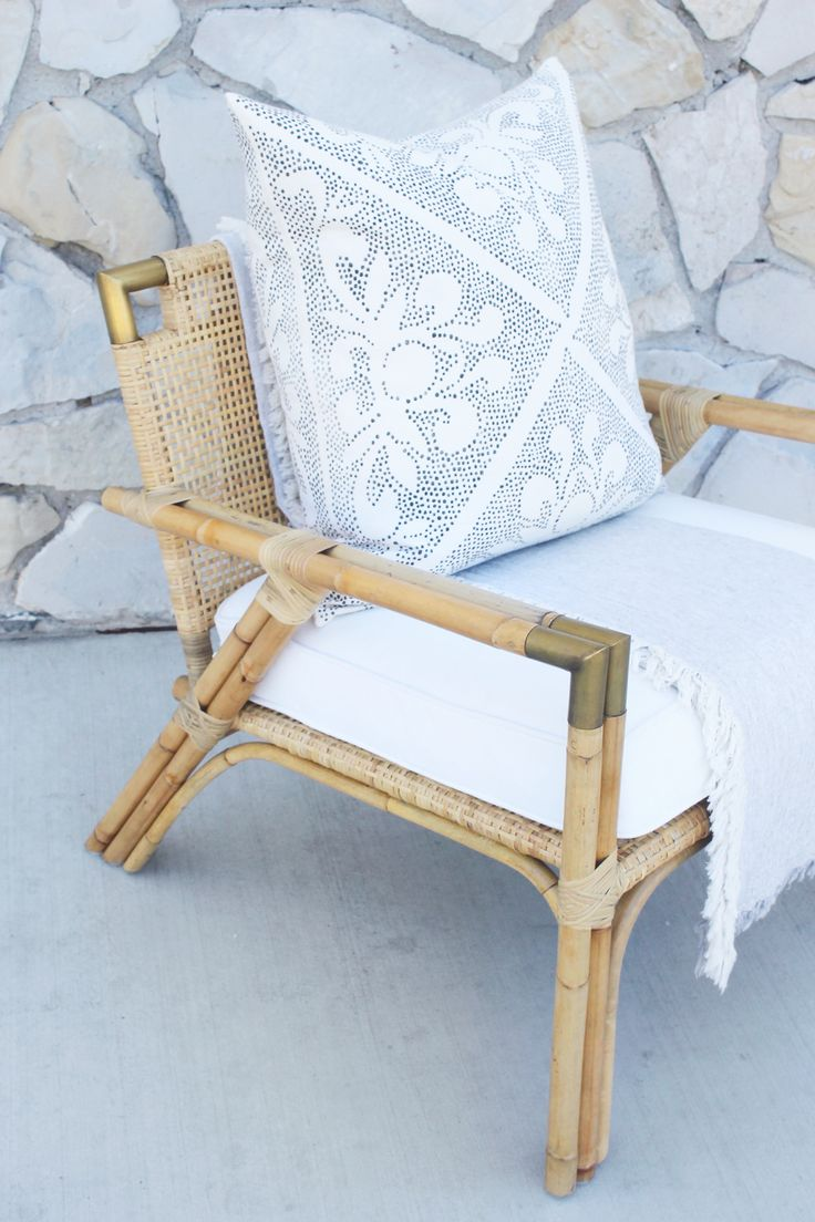 Rattan chair with brass detailing | Image via Serena & Lily Newport Beach