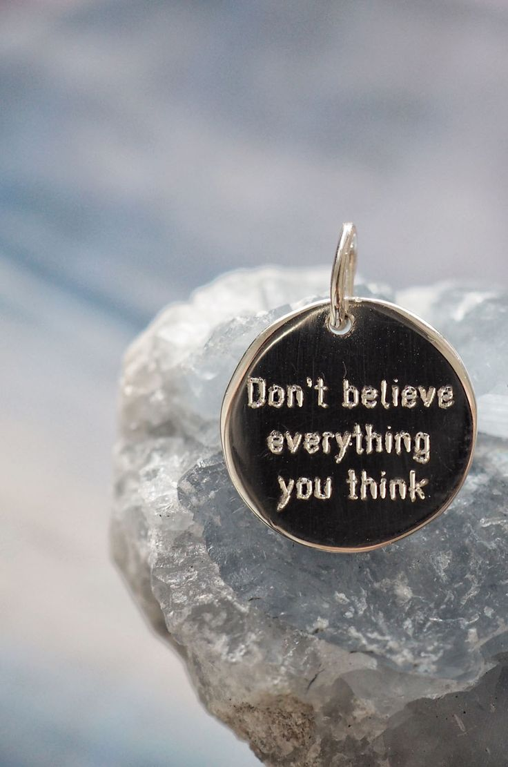 """Tiny minimalist sterling silver round pendants with simple font motivational saying """"Don't believe everything you think"""""""