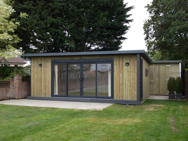 6.8x4.8m garden office with 4m graphite double sliding door set, composite deck & fitted vertical blinds, from £24,495 (inc. VAT)