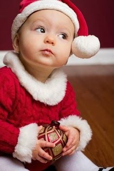 Cute baby in Christmas outfits looking adorable | Fashion World