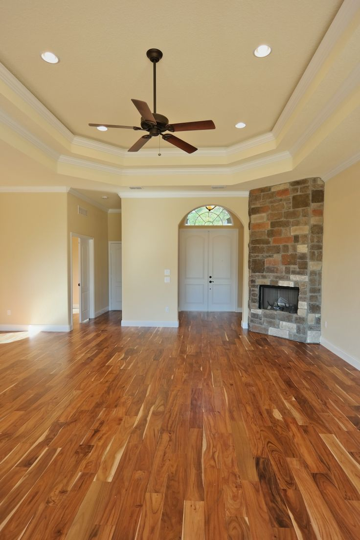 This home features a wood burning fire place and gorgeous for Tobacco road acacia wood flooring