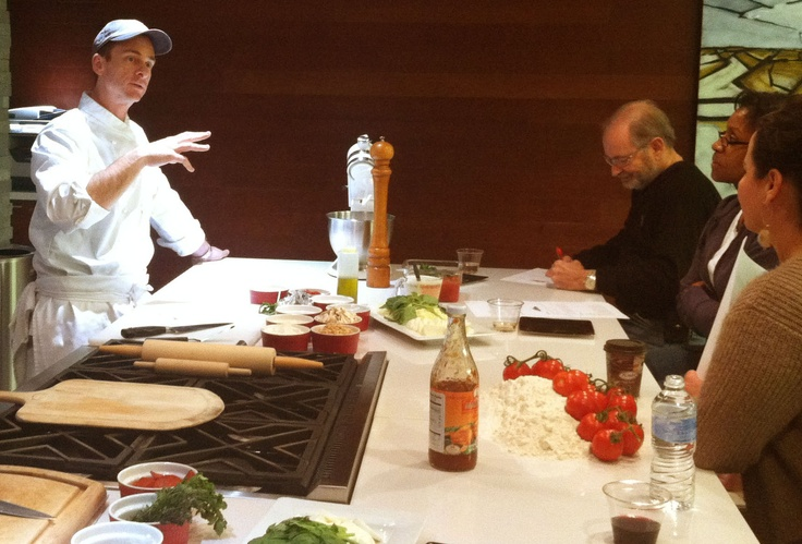 Big City Chefs' Denver Teaching Chef Andrew, describing how to make pizza at a private group cooking class.
