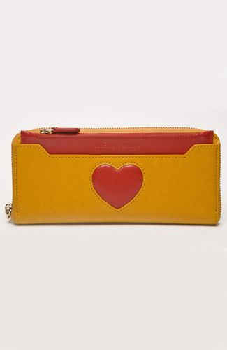 Small clutch with zipper, detachable red wallet. Heart-shaped opening. 20 cm width.