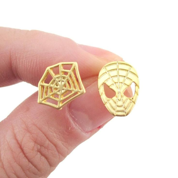 A pair of earrings inspired by Marvel's super hero Spider-Man! They are made in the shape of Spiderman's mask and a spiderweb in gold. Shop Online Now!