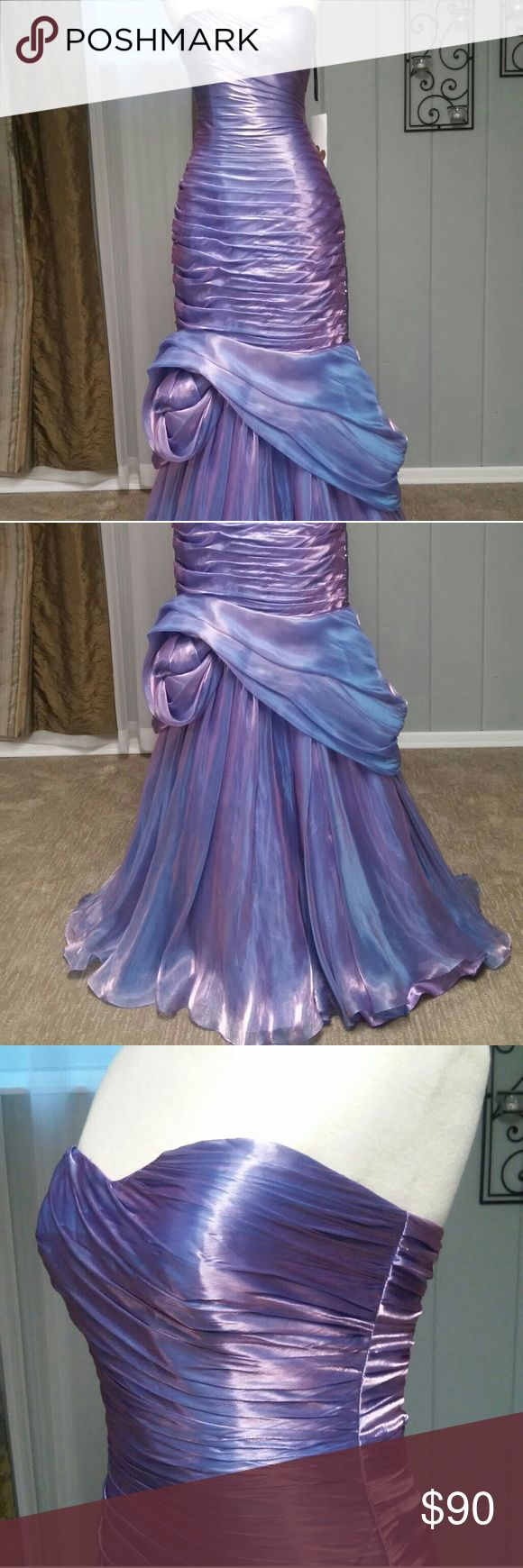 Violet Red (Purple) Floor-Length Gown   Size 4 This is a stunning floor length gown in iridescent violet red. This would be perfect for any formal party like prom, a formal dinner or holiday party, pageant  etc.  - Size 4 - Silky organza fabric - Floor length, mermaid style - Fully lined - Built in layer of tooling for fullness in the skirt -  Like new - still has original tags - Designer: Princrss Proms - Original ticketed price: $539  Message me if you're interested or have any questions…