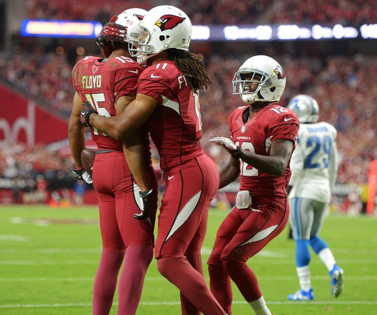 Nov 16, 2014; Glendale, AZ, USA; Arizona Cardinals receiver Michael Floyd (15) celebrates with receivers Larry Fitzgerald (11) and John Brown (12) after scoring on a 12-yard touchdown pass in the first quarter against the Detroit Lions at University of Phoenix Stadium. (3402×2850)