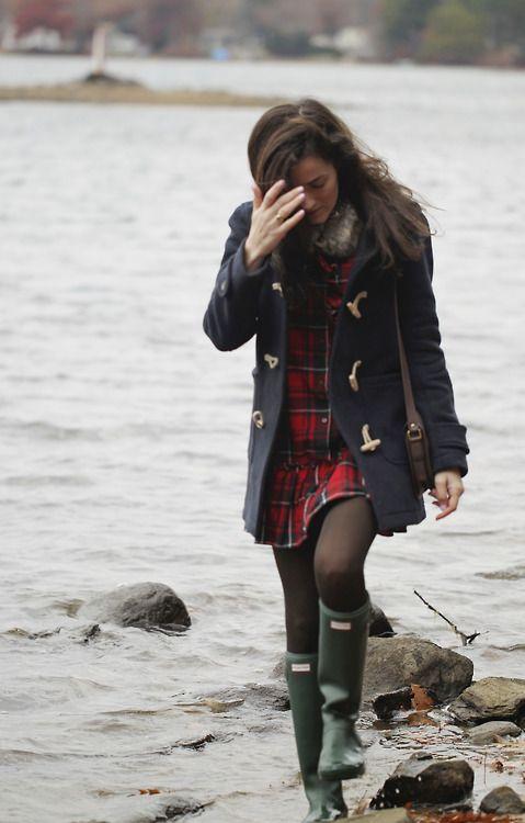 Plaid dress, black tights, and rain boots.