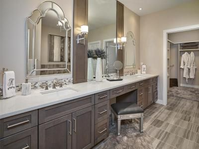 Master Ensuite with extra long vanity, two undermount sinks, makeup desk. walk-in closet. decorative mirrors and sconces | Kimberley Homes #bathroom #bathroomdesign #bathroomidea #freestandingtub #interiordesign #newhomedesign #homedesign #newhome #customhome #yegre #buildwithkimberley #kimberleyhomes