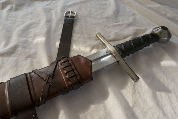 Leatherwork and woodwork. This handmade and hand-stitched sword scabbard is based on a medieval design and is made from ash wood and leather.